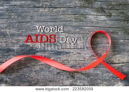 Red Heart Shaped Ribbon Awareness On Old Aged Wood For World Aids Day Concept