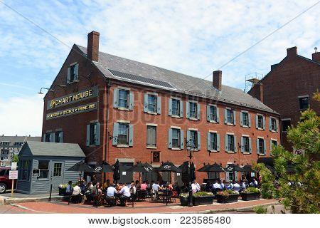 BOSTON - JUN. 11, 2014: Chart House on Long Wharf at waterfront of Boston, Massachusetts, USA.