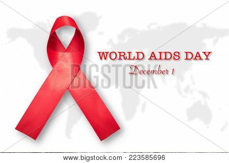 World aids day and national HIV/AIDS and aging awareness month campaign concept with Aids red ribbon Symbolic satin bow isolated on white world map background with clipping path