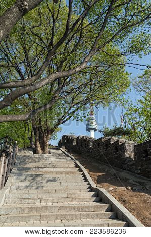 Stairway, old fortress wall (or City Wall) and N Seoul Tower (Namsan Tower or Seoul Tower) at the Namsan Hill (or Namsan Park or Namsan Mountain) in Seoul, South Korea.