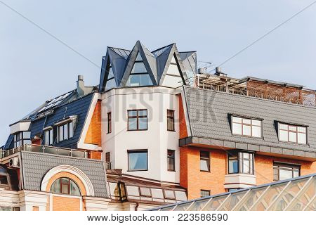 Upper floors and the attic of a house in Moscow, Russia. Interesting attic windows, gables and bay windows.