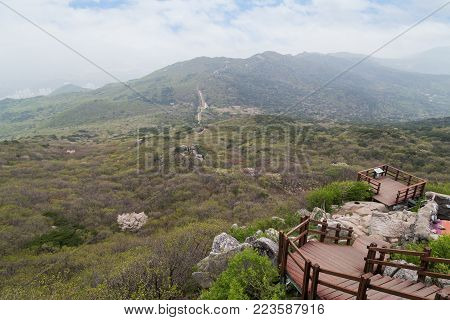 View of stairs, lookout area and lush landscape at the Geumjeongsan Mountain in Busan, South Korea.