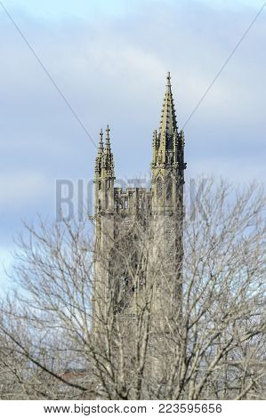Fairhaven, Massachusetts, USA - January 24, 2018: Tower of Unitarian Church rises above trees in winter