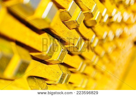 New yellow wooden formwork stacked in a warehouse in large piles. Materials for the construction and erection of concrete structures. Abstract background, soft focus and beautiful bokeh.