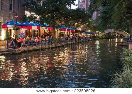 SAN ANTONIO, TX - OCTOBER 27, 2017: Visitors dine along the Riverwalk in San Antonio, Texas