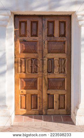Old wooden paneled exterior doors in doorway