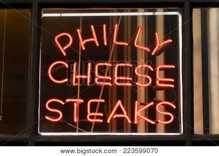 PHILADELPHIA, PA - DECEMBER 13, 2014: Philadelphia Philly Cheese Steak Neon Sign in a local restaurant