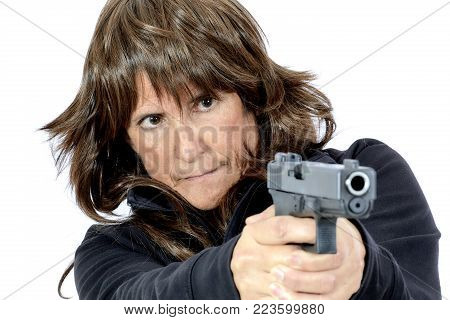 Attractive Woman Aiming A Handgun