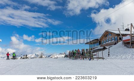 Dolomites, ski area with beautiful slopes. Empty ski slope in winter on a sunny day. Prepare ski slope. Alpe Cermis, Italy