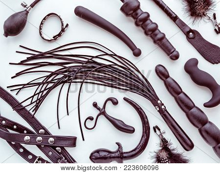 Different sex toys: whip, dildo, prostate massager, bondage, anal plug and others