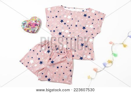 Composition with fashionable pajama in the stars on white background. gift composition. garland. Valentine's Day