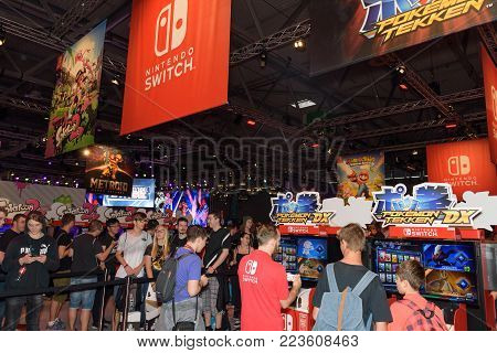 Cologne, Germany - August 24, 2017: Trade fair visitors playing games and waiting  at the booth of the company Nintendo at Gamescom 2017. Gamescom is a trade fair for video games held annually in Cologne.
