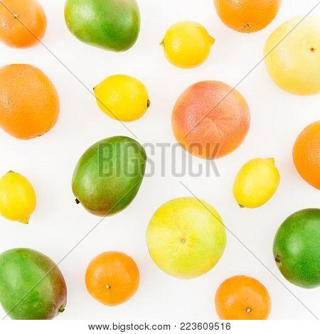 Fruits - lemon, orange, grapefruit, sweetie and mango isolated on white background. Flat lay, top view. Summer background