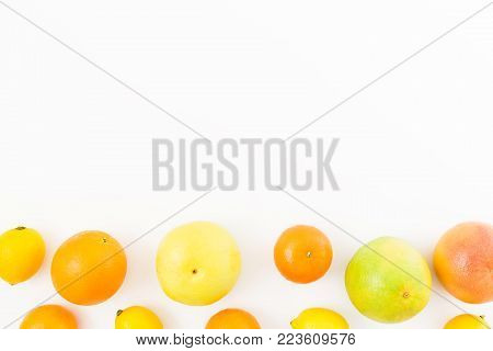 Citrus fruits - lemon, orange, grapefruit, sweetie and pomelo on white background. Flat lay, top view.