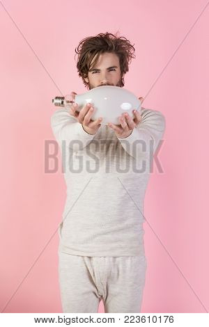 Man With Disheveled Hair Hold Big Lamp, Thumb Up