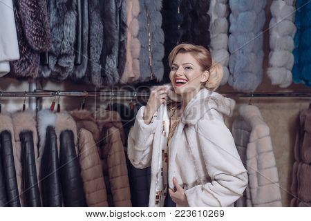 Purchase, shopping, business, moneybags. Shopping, seller, fashion model, customer. Woman in fur coat, shopaholic. Fashion and beauty, winter, fur. sensual woman in fur, luxury, moneybags, business.
