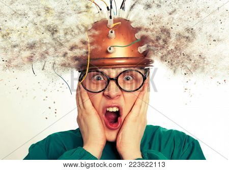 Man crazy inventor wearing a helmet brain research. Brainstorm
