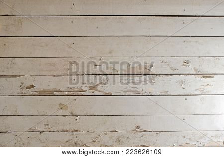 old, dirty, wooden surface, sometimes painted white. Non-uniform lighting. Perfect texture for creativity. Beautiful background for design