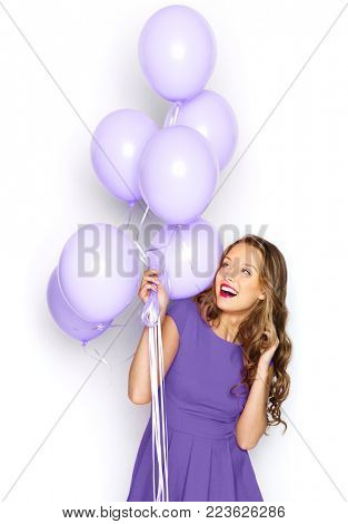 people, holidays and fashion concept - happy young woman or teen girl in ultra violet dress with helium air balloons