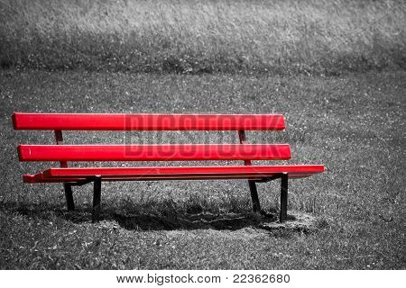 Empty red bench in park