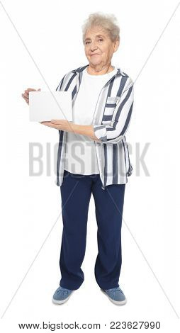 Senior woman with blank sheet of paper for advertising on white background