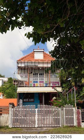 The wooden colored house typical for Caribbean Islands, Martinique, french West Indies.