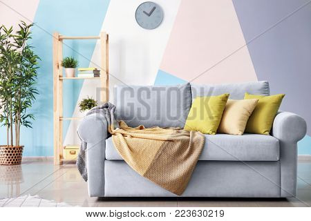 Living room interior with comfortable couch and soft pillows