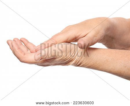 Hands of senior woman with healthy skin softened by cream with moisturizing effect, on white background