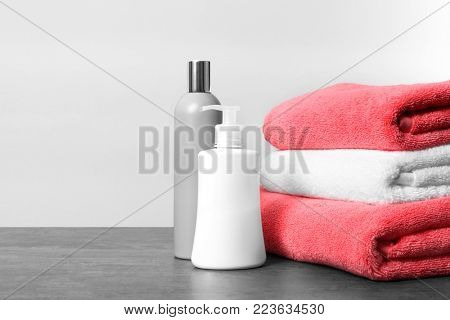 Clean towels and toiletries on table