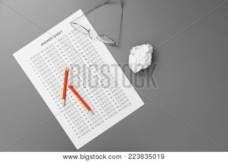 Broken pencil, glasses and test sheet on table, top view. Preparation for exam