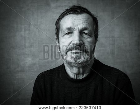 An elderly man's face. Black and white portrait