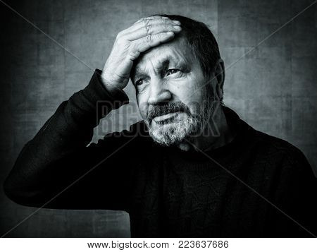 Sad elderly bearded man black and white portrait