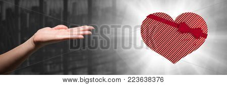 Digital composite of open hand and heart gift by office window