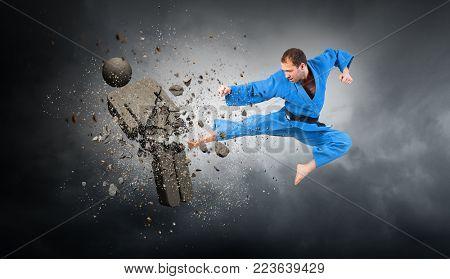 Karate man attack opponent. Mixed media