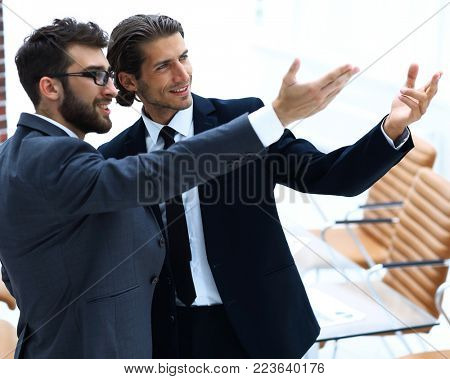 business partners pointing at blank space