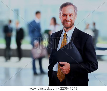 Successful businessman at the office leading a group.