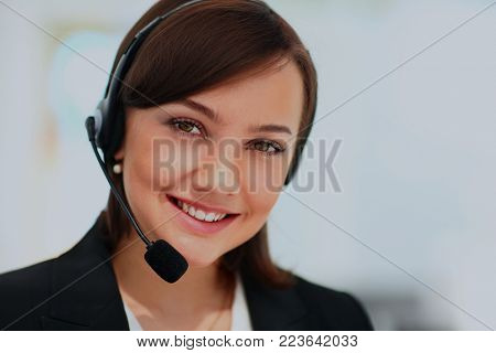 Portrait of happy smiling cheerful support phone operator.