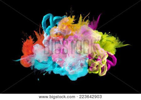 Acrylic colors in water. Ink blot. Abstract background. Isolated on black.