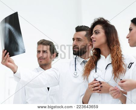Portrait of young male doctors looking at x-ray