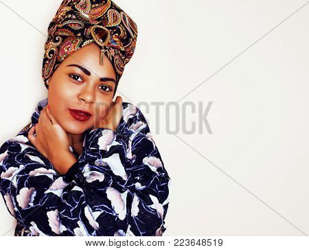 young pretty african american woman isolated on white background happy smiling, wearing bright shawl and jewelry. lifestyle people concept close up