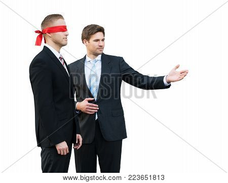 Confident Young Businessman Assisting Blindfolded Partner On White Background