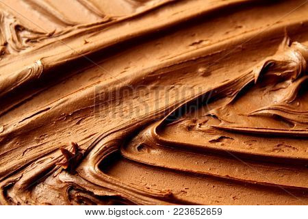 Chocolate as background / Chocolate is a typically sweet, usually brown food preparation of Theobroma cacao seeds, roasted and ground.