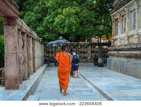 Bodhgaya, India - Jul 9, 2015. A Monk Walking At Mahabodhi Temple In Bodhgaya, India. Bodh Gaya Is C