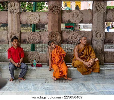 Bodhgaya, India - Jul 9, 2015. People Sitting At Mahabodhi Temple In Bodhgaya, India. Bodh Gaya Is C