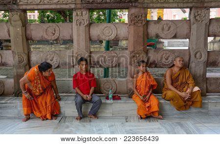 Bodhgaya, India - Jul 9, 2015. People Praying At Mahabodhi Temple In Bodhgaya, India. Bodh Gaya Is C