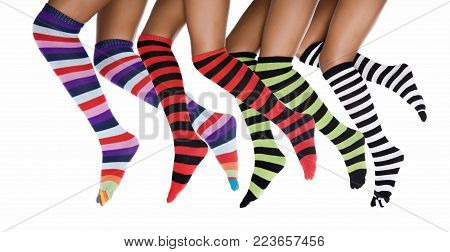 Four African woman legs with stripes multicolored socks