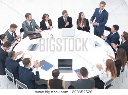 business people applauding speaker at a business meeting.