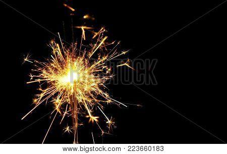 Christmas and new year celebration concept : Bright burning Christmas sparkle on black background