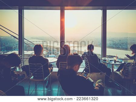 Osaka, Japan - April 3, 2017: Umeda Sky Building, Floating Garden Observatory. The tourists sit and watch the sunset on the top floor of the building. Umeda Sky Building is popular landmark in Osaka, Japan