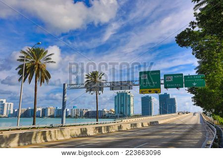 Signs welcome visitors to Miami Beach as they cross the MacArthur Causeway Bridge.